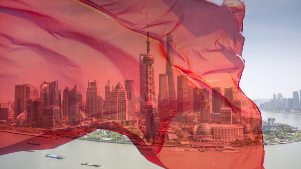 View of Pudong business district with a transparent Chinese flag superimposed.