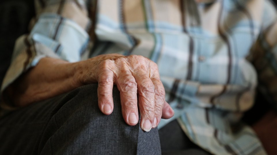 Closeup on a hand of an old man.