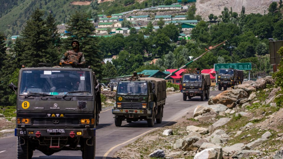 An Indian army convoy drives towards Leh, on a highway bordering China, on June 19, 2020 in Gagangir, India.
