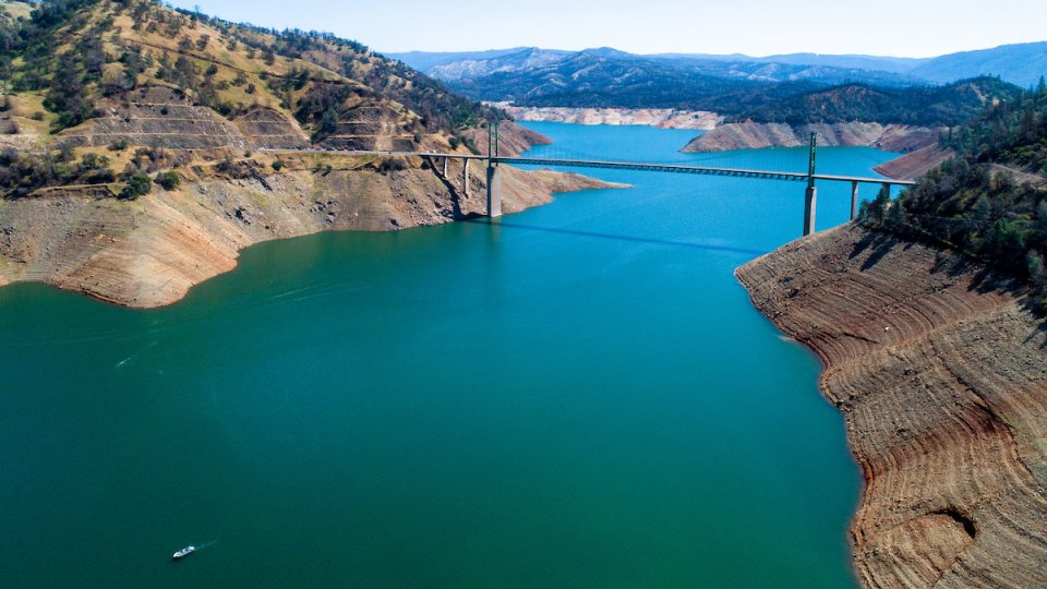 A bridge across a reservoir with low levels of water due to drought