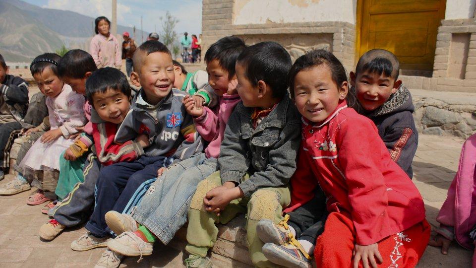 rural kids sitting together