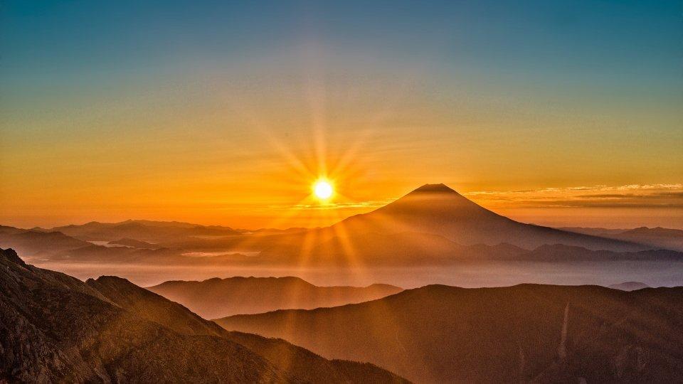 Rising sun over Mount Fuji