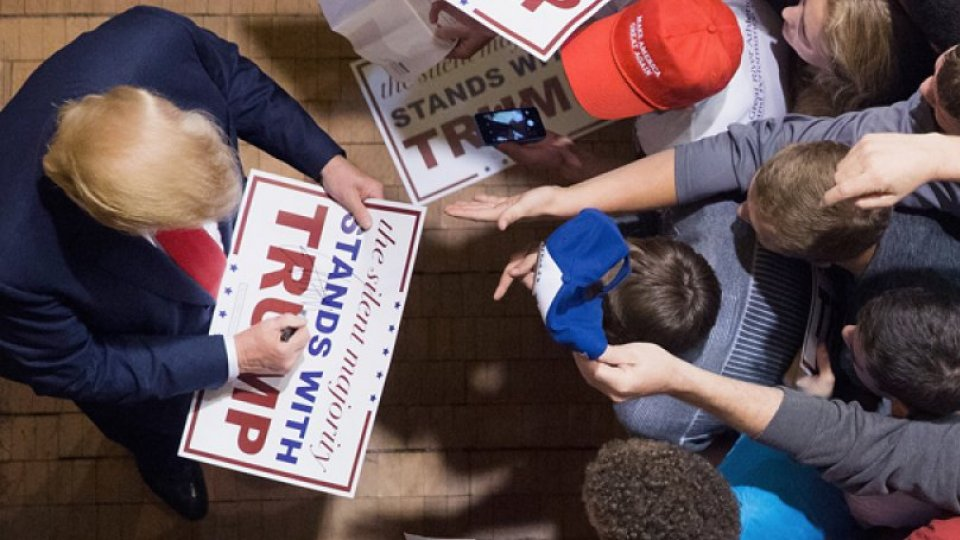 Trump signs campaign poster