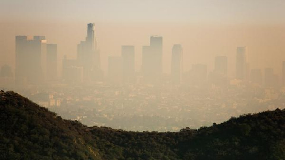 A hazy orange sky and the Los Angeles skyline