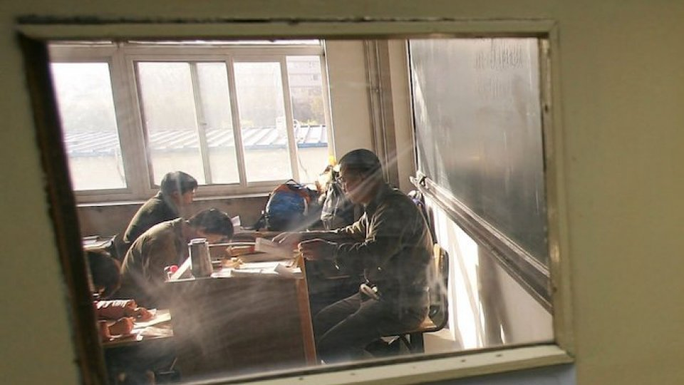 Children in China study in a classroom