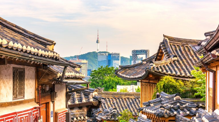 Bukchon Hanok Village with modern buildings in the background in Seoul, South Korea