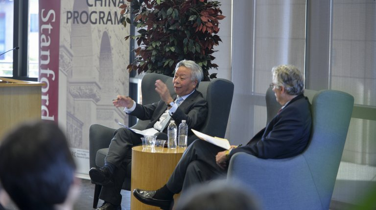 AIIB President Jin Liqun in conversation with Thomas Fingar in front of an audience