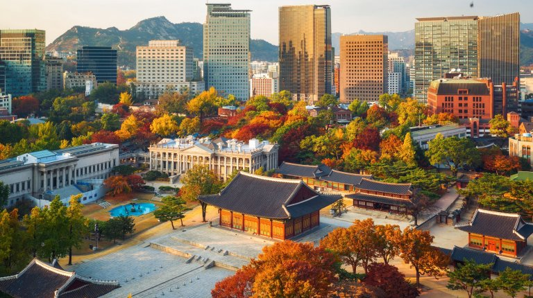 Autumn scene of the Deoksugung royal palace and Seoul City Hall from top view in Seoul,South Korea.