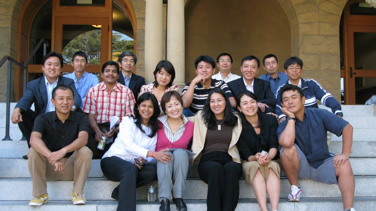 Global Affiliate visiting fellows (2008-9 cohort) posing for the camera, sitting on the steps at the entrance to Encina Hall, Stanford. Photo credit: Denise Masumoto.