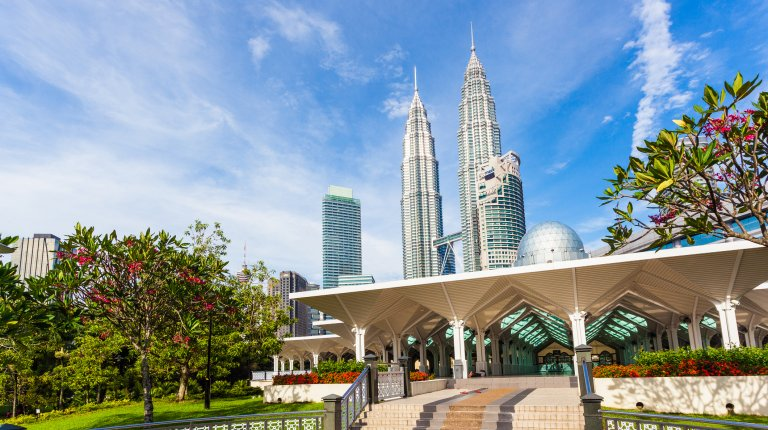 Syakirin Mosque with the Petronas Towers in the background, Kuala Lumpur, Malaysia