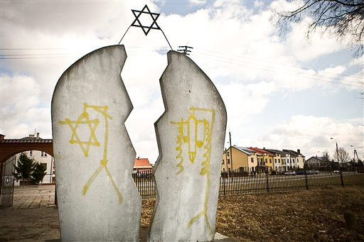 Memorial plaque stained with anti-Semitic vandalism in Mazowieckie, Poland, March 19, 2012.