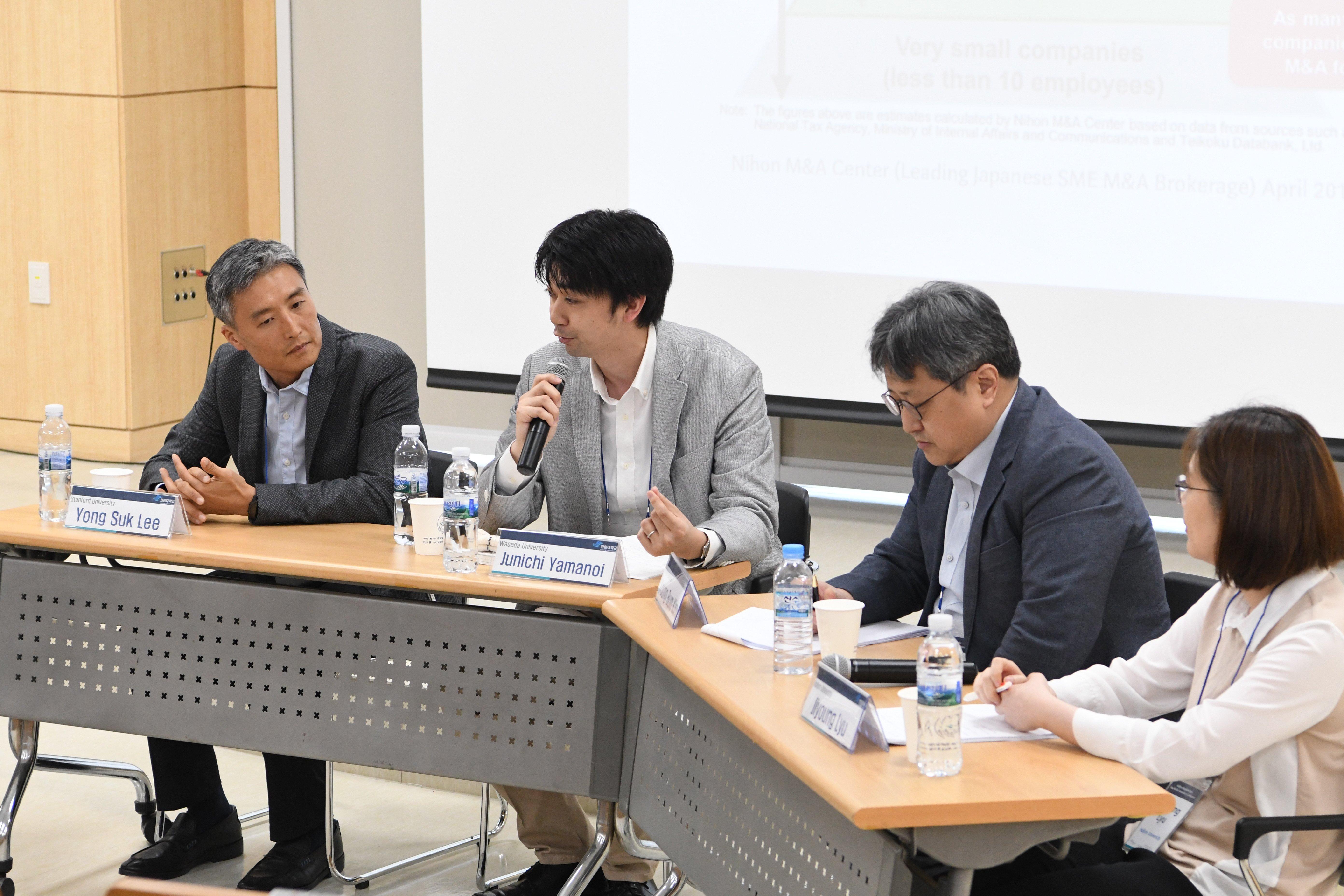 Yong Suk Lee , Junichi Yamanoi , Young-Bum Kim, and Jiyoung Liu seated at a table