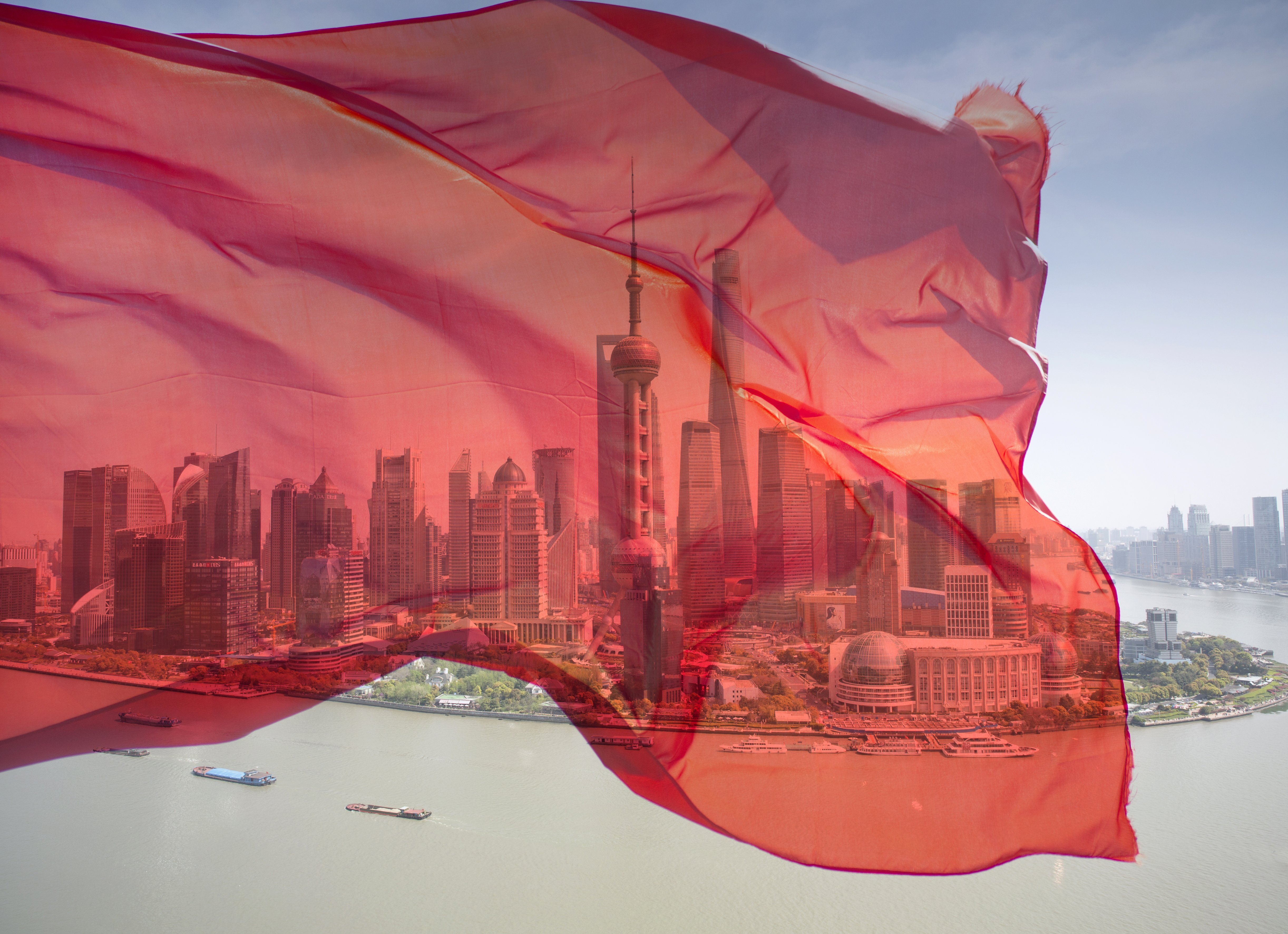 Image of red flag over the Shanghai Bund