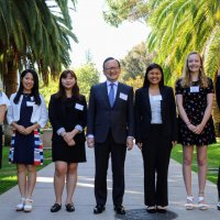 The Honorable Tomochika Uyama with six student honorees