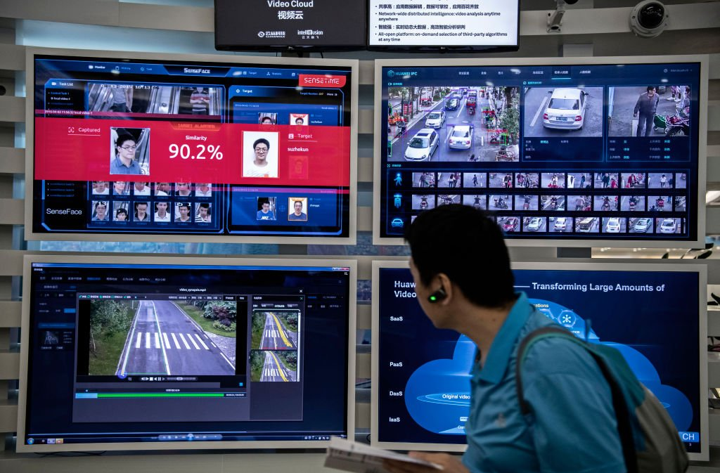 A display for facial recognition and artificial intelligence is seen on monitors at Huawei's Bantian campus on April 26, 2019 in Shenzhen, China.