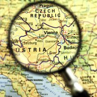 Image of a map with magnifying glass highlighting Austria.