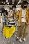 Shoppers wearing masks in a store in Beijing.