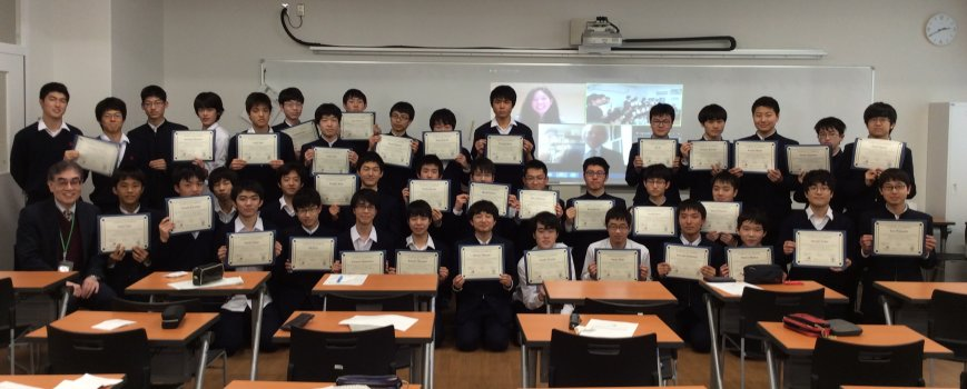 Takatsuki students (with Ishimatsu and Mukai projected on screen)