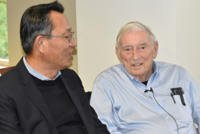 Arthur Bienenstock and Gi-Wook Shin seated at a conference room.