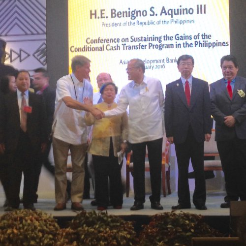 CISAC senior research scholar Joe Felter shakes hands with Philippine President Benigno Aquino onstage at a conference in the Philippine capital of Manila.