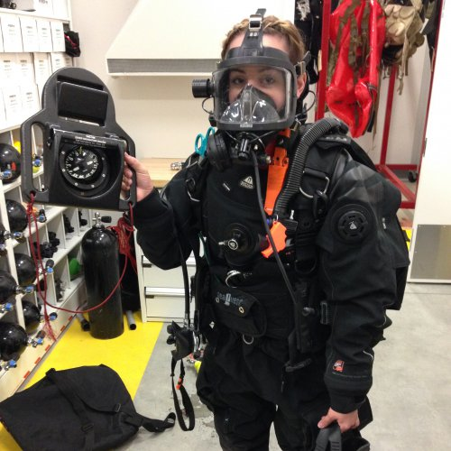 Rachel Olney, a graduate student in mechanical engineering, tries on a military-grade dry suit on a visit to the 129th Rescue Wing at Moffett Field.