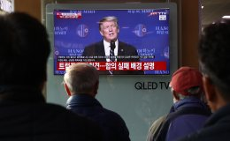 South Koreans watch TV screen reporting on the U.S. President Donald Trump press conference at Seoul Railway Station on February 28, 2019 in Seoul, South Korea