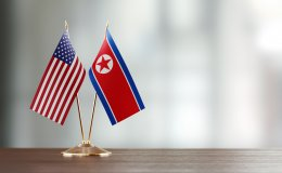 U.S. and DPRK Flags on Table
