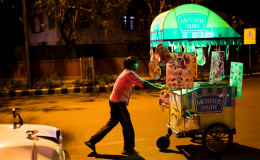 An ice cream vendor pushes his cart in front of Lodhi Gardens in New Delhi, India.