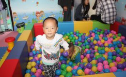 A young Chinese boy plays in an early childhood development center