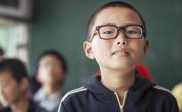 Boy with glasses in rural China, provided by social enterprise Smart Vision and REAP.