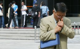 A man smokes in the street in Seoul, South Korea.