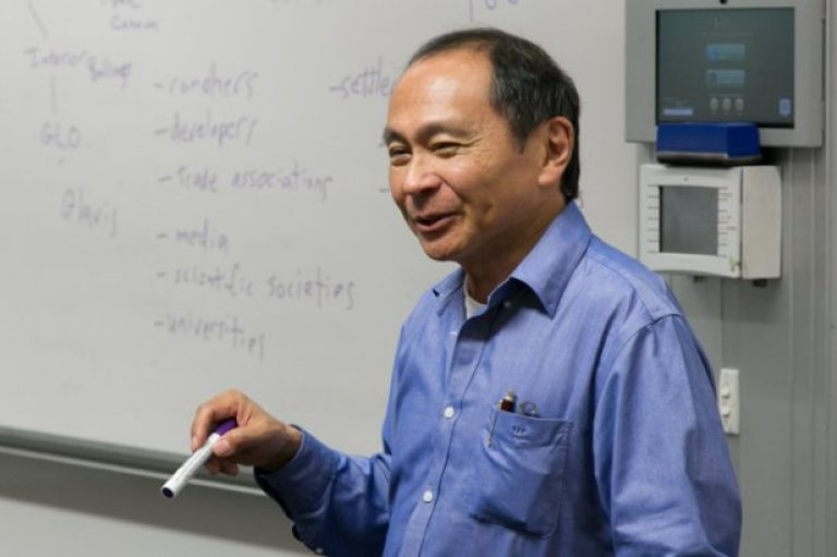 Francis Fukuyama teaching in front of a whiteboard