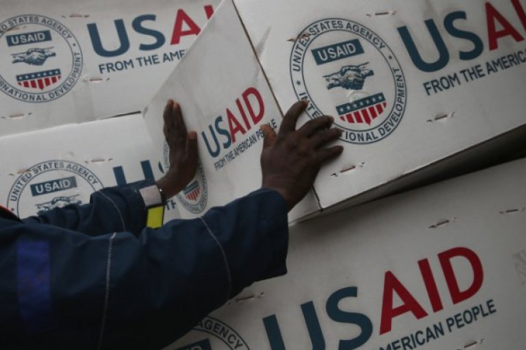 HARBEL, LIBERIA—Workers unload medical supplies to fight the Ebola epidemic from a USAID cargo flight on August 24, 2014 in Harbel, Liberia.
