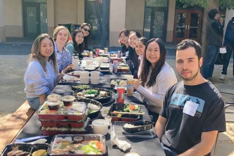 students gathered for a luncheon