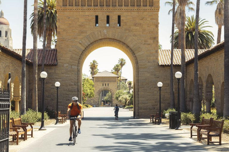 Student riding bicycle on Stanford University campus