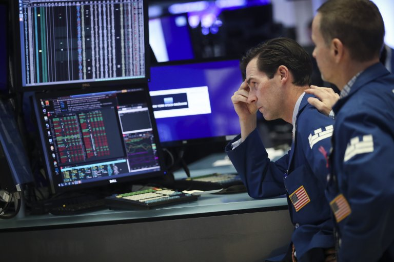 Traders and financial professionals work ahead of the closing bell on the floor of the New York Stock Exchange (NYSE) on August 1, 2019 in New York City.