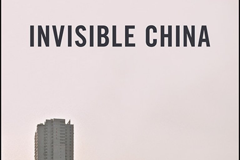 """Book cover for """"Invisible China: How the Urban-Rural Divide Threatens China's Rise"""" showing a man watering a field in front of high rise buildings."""