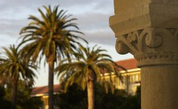 Architectural detail on Stanford colonnade with palm trees in the background