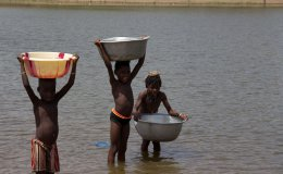 boys collecting water