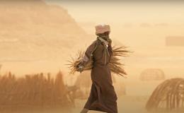 Person walking through dusty desert area