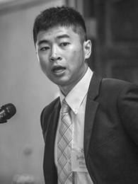 Man speaking into a microphone