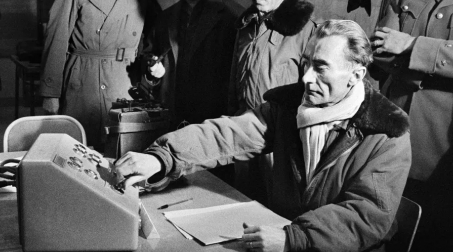 Director of nuclear experiment center, General Jean Thiry, pressing a button to trigger the explosion of the third French atomic bomb at the Reggane test site in the Algerian Sahara, December 27, 1960