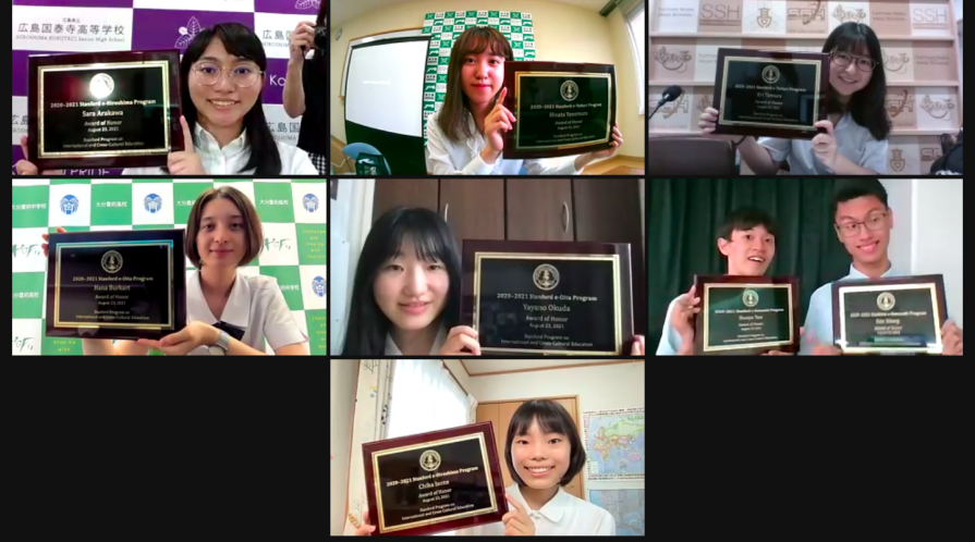 Photo of student honorees holding plaques