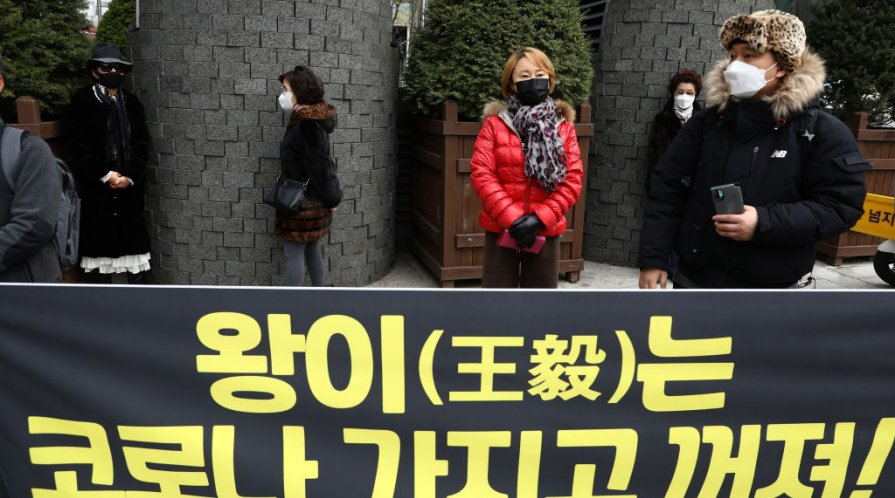 Protesters participate in a rally oppose a planned visit by Chinese Foreign Minister Wang Yi near the Chinese Embassy on November 25, 2020 in Seoul, South Korea.
