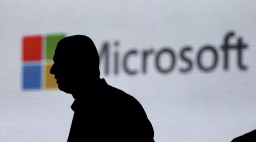 Outline of person in front of Microsoft Logo