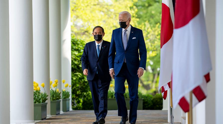 President Biden and President Suga walk through the Rose Garden colonnade at the White House