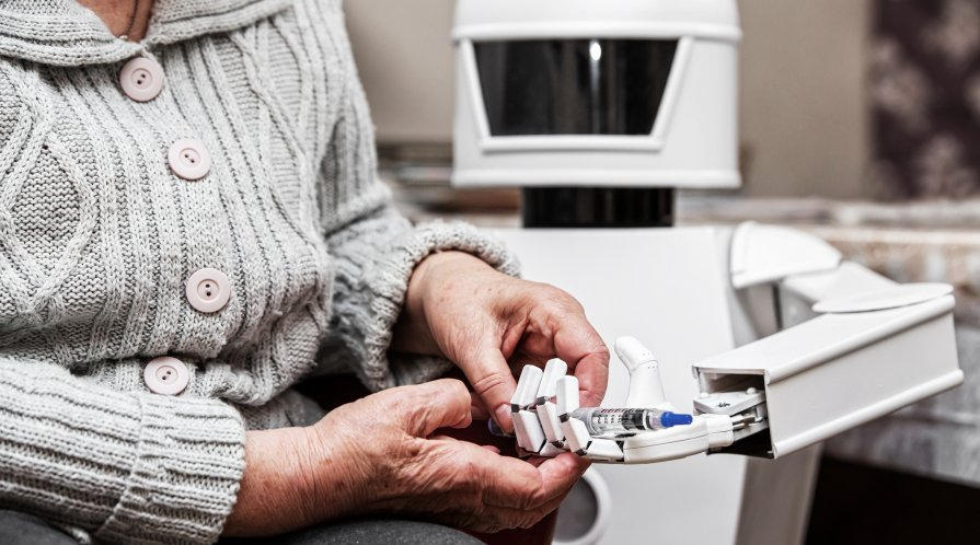 Autonomous caregiver robot is holding a insulin syringe, giving it to an senior adult woman, concept ambient assisted living