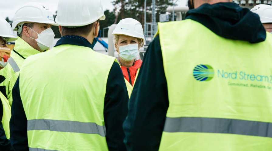 Manuela Schwesig (C), State Premier of Mecklenburg-Western Pomerania, talks with representatives of the Nord Stream 2 pipeline during a visit to the industrial port and the landfall facility of the joint German-Russian pipeline project in Lubmin, Germany,