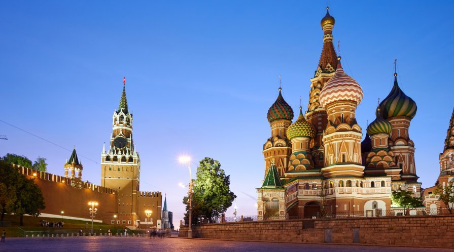 Kremlin wall (left) and Saint Basil's Cathedral (right), in Moscow, Russia.