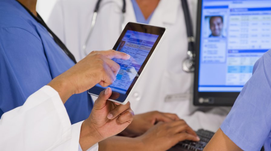 Health-care providers looking at electronic medical records